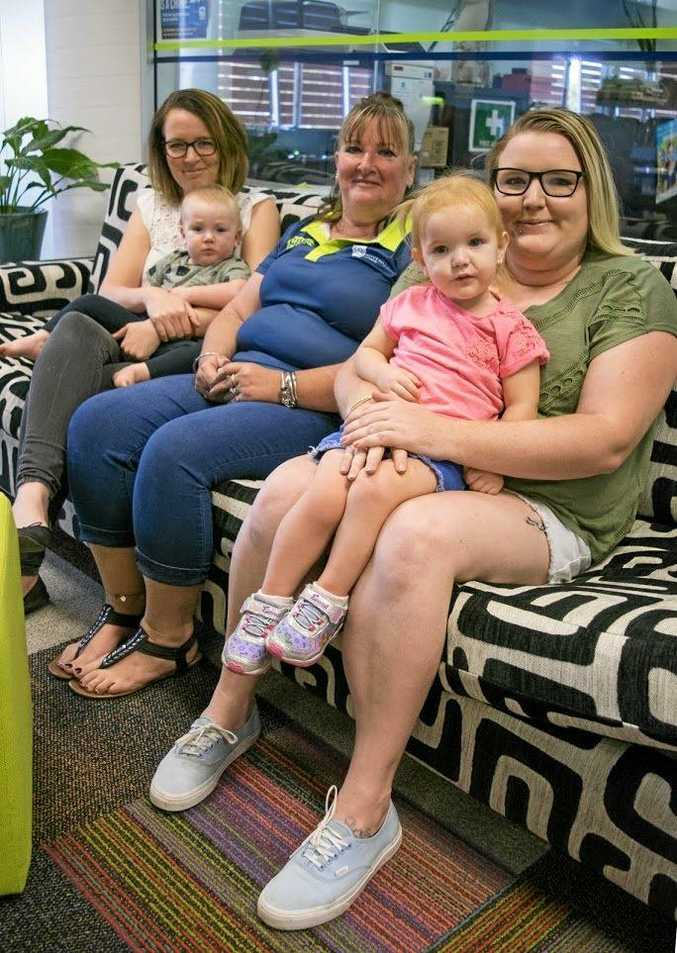 Sue Arnold and daughters Lisa (left with son Alec), and Lauren, with daughter Alexandria, are making study a family affair at CQ University's Noosa campus.