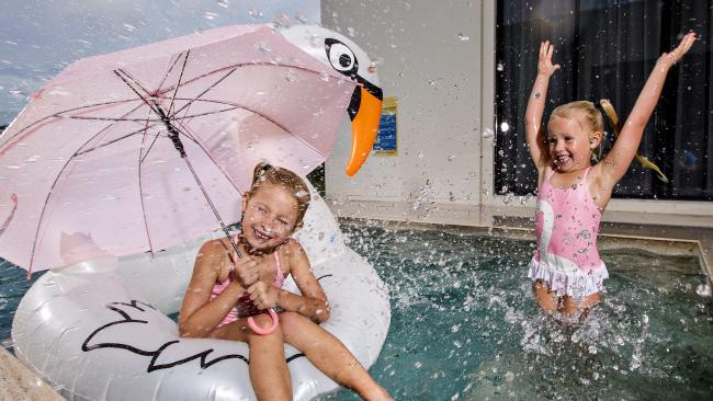 Summer on the Gold Coast is here, and sisters Mia Reid, 6, and Zoe Reid, 5, are ready for it. Picture: Jerad Williams