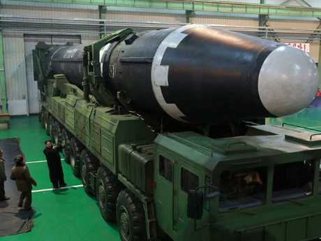Check out the size of this … North Korean leader Kim Jong-un inspect the Hwasong-15 intercontinental ballistic missile. Picture: Korean Central News Agency/Korea News Service via AP