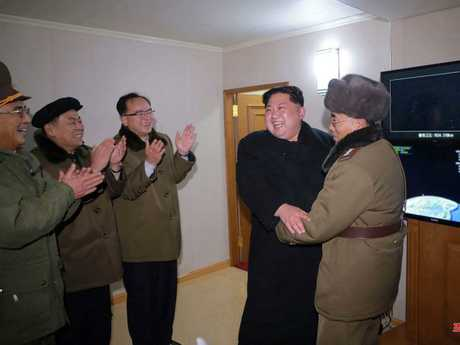 Kim Jong-un celebrates the success of his scary new weapon. Picture: AFP/Korean Central News Agency/Korea News Service