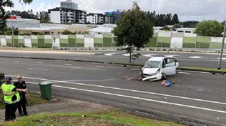 The damaged car at the scene.