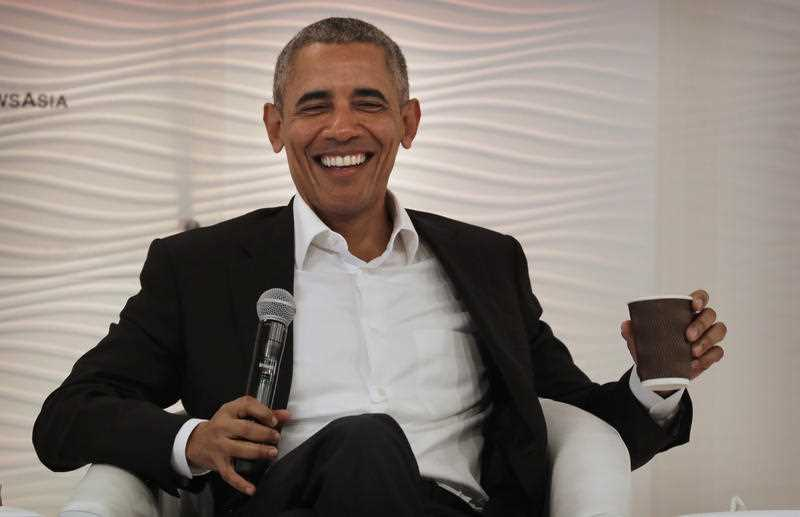 Former U.S. President Barack Obama laughs after answering a question during a leadership summit in New Delhi, India, Friday, Dec. 1, 2017. Obama was one of the keynote speakers at the event organized by the Hindustan Times newspaper.