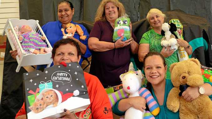 TOYS GALORE: IWC team members Lee Lingwoodock, Lee Hammond, Leanne Connors, Kiama Theuerkauf-Smith and Jenny Springham with some of the toys.