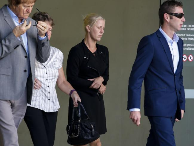 Heidi Strbak (centre) leaves the Supreme Court in Brisbane with family after pleading guilty to manslaughter on the basis of criminal negligence. Picture: Glenn Hunt.