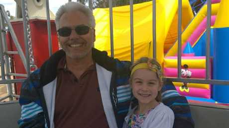 Grandfather Peter Rowe, 52, with his granddaughter Olyviah.