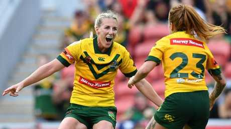 Ali Brigginshaw celebrates with Jillaroos teammate Caitlin Moran.