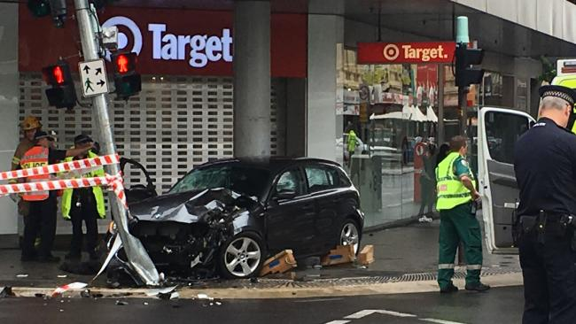 A car has crashed into a traffic light at the intersection of Rundle St and Pulteney St in the CBD. Picture: Mitch Mott