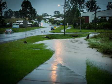 The footpath on Corella Rd, inundated with water.