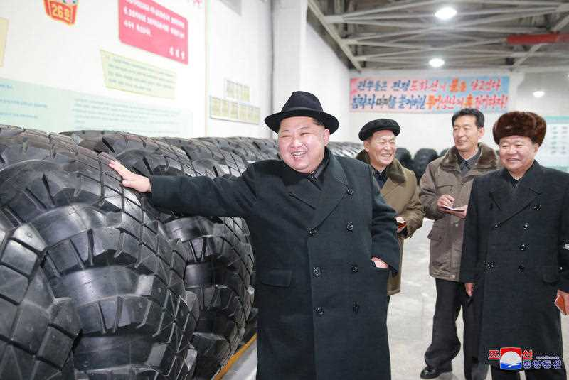 Kim Jong-un inspects a tire factory in North Korea.