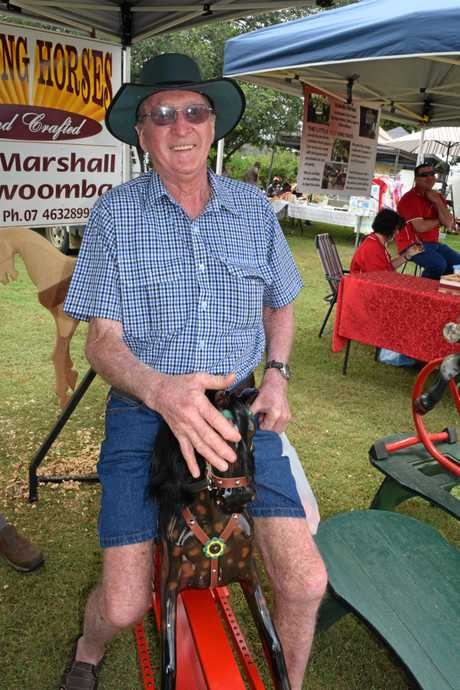 Noel Luck from Meringandan tries out a rocking horse for the first time ever at the Glengallan Christmas markets.