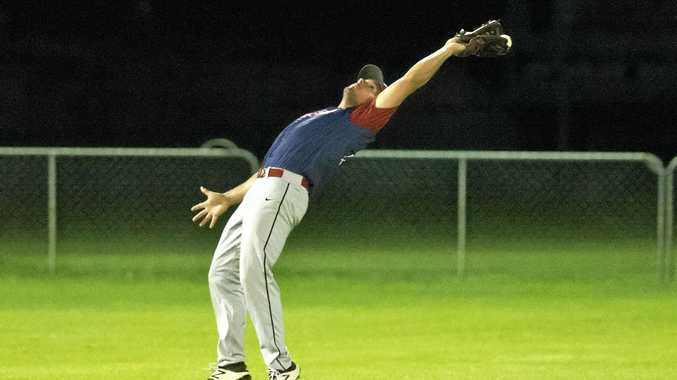 Toowoomba Rangers import Ketchum Marsh just gets a glove to the ball in their game against Redland Rays on Saturday night.