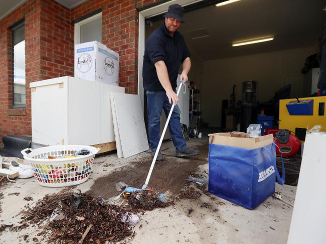 Matthew Willey begins the clean-up in his Euroa home. Picture: Alex Coppel.