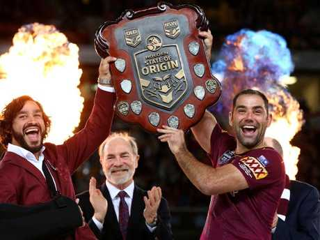 Johnathan Thurston and Cameron Smith hold the shield up to celebrate winning the 2017 Origin series. Pics Adam Head