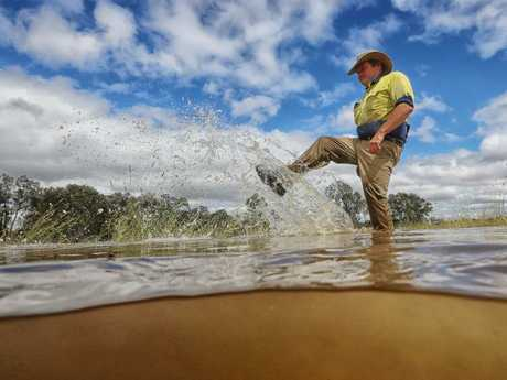 Steve Mooney at his flooded leased farmland in Everton, between Wangaratta and Myrtleford. Picture: Alex Coppel.