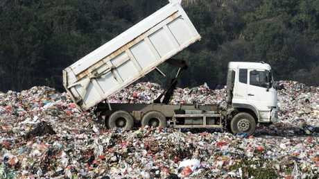 Waster from NSW landfill sites is being dug up and transported to Queensland to be buried again.