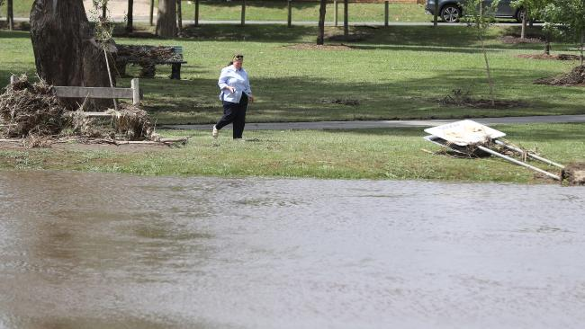A woman looks over the flood damage in Euroa. Picture: Alex Coppel.