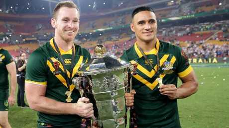 Michael Morgan of the Kangaroos and Valentine Holmes.
