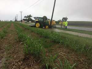 Tractor hits pole in wet weather crash