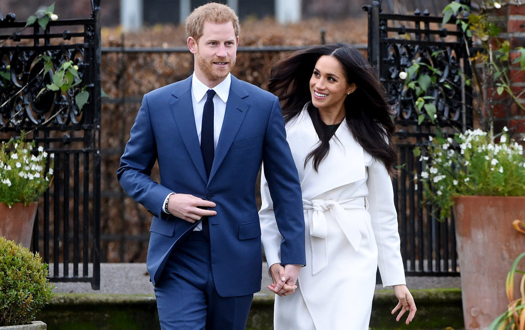 epa06354517 Britain's Prince Harry (L) poses with his fiancee, US actress Meghan Markle during a photocall after announcing their engagement in the Sunken Garden at Kensington Palace in London, Britain, 27 November 2017. Clarence House said in a statement that the couple's wedding ceremony will take place in spring 2018.