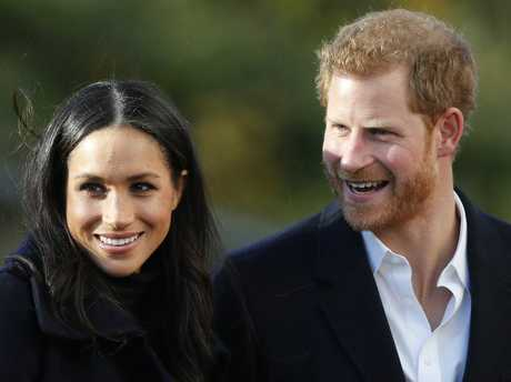 FILE - In this Dec. 1, 2017 file photo, Britain's Prince Harry and his fiancee Meghan Markle arrive at Nottingham Academy in Nottingham, England. For some black women, Meghan Markle and Prince Harrys engagement was something more. One of the worlds most eligible bachelors had chosen someone who looked like them and grew up like them.