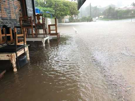 CLOSED: The Velo Project at Mooloolaba has had to close as floodwaters lap at the doors.