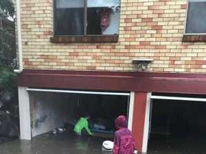 FLOODED: Homes, streets go under, Mt Coolum waterfall flows