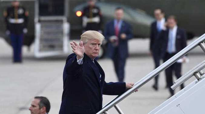 President Donald Trump waves a she walks up the steps of Air Force One at John F. Kennedy International Airport in New York, Saturday, Dec. 2, 2017. Trump spent the day in New York attending a trio of fundraisers.