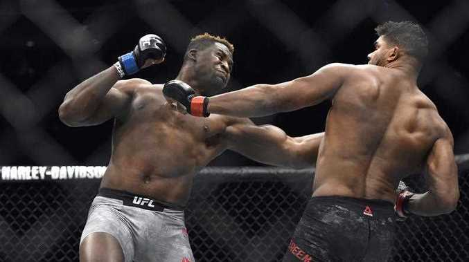 Francis Ngannou, left, hits Alistair Overeem in the first round during a UFC 218 heavyweight mixed martial arts bout, Saturday, Dec. 2, 2017 in Detroit. Ngannou defeated Overeem by first-round knockout.