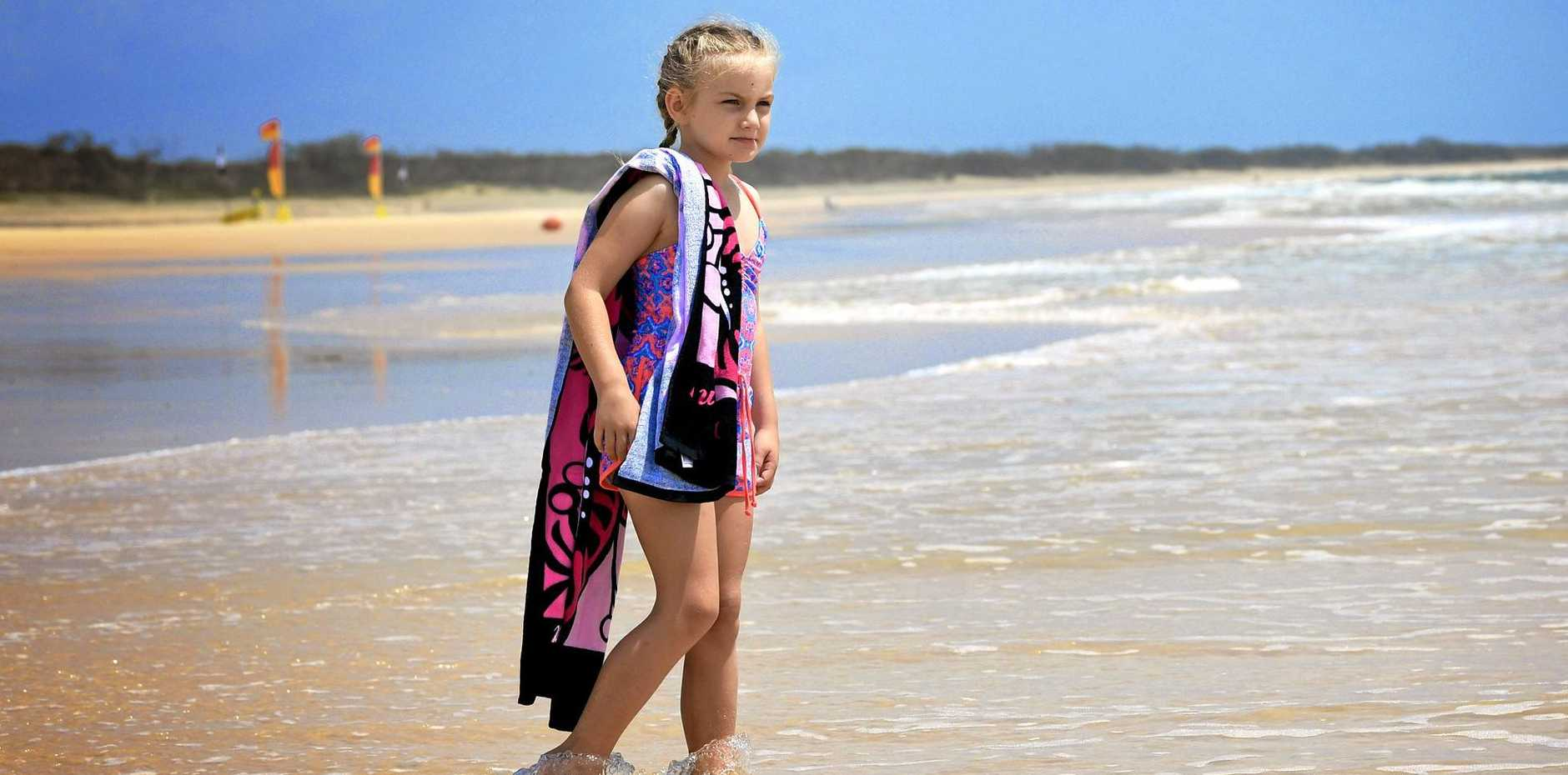 TOP SPOT: Emilie Dwin at Rainbow Beach in one of its quieter times, which are becoming less common.
