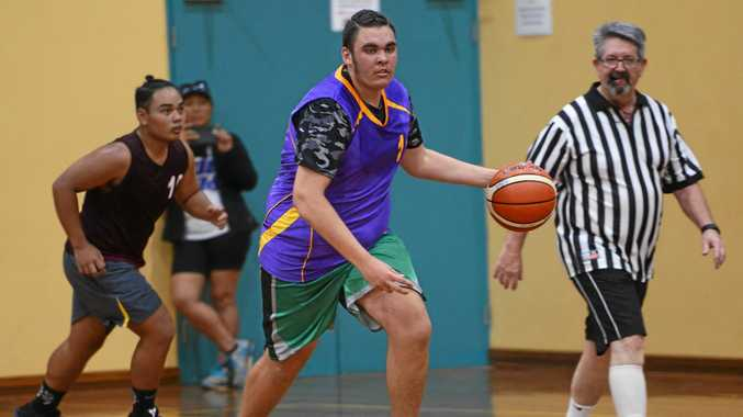 A Tropics player dribbles the ball  down the court.