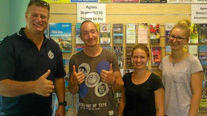 GOOD SPIRITS: Senior Constable Simon Burns (left) with the unfortunate backpacker and his two companions.