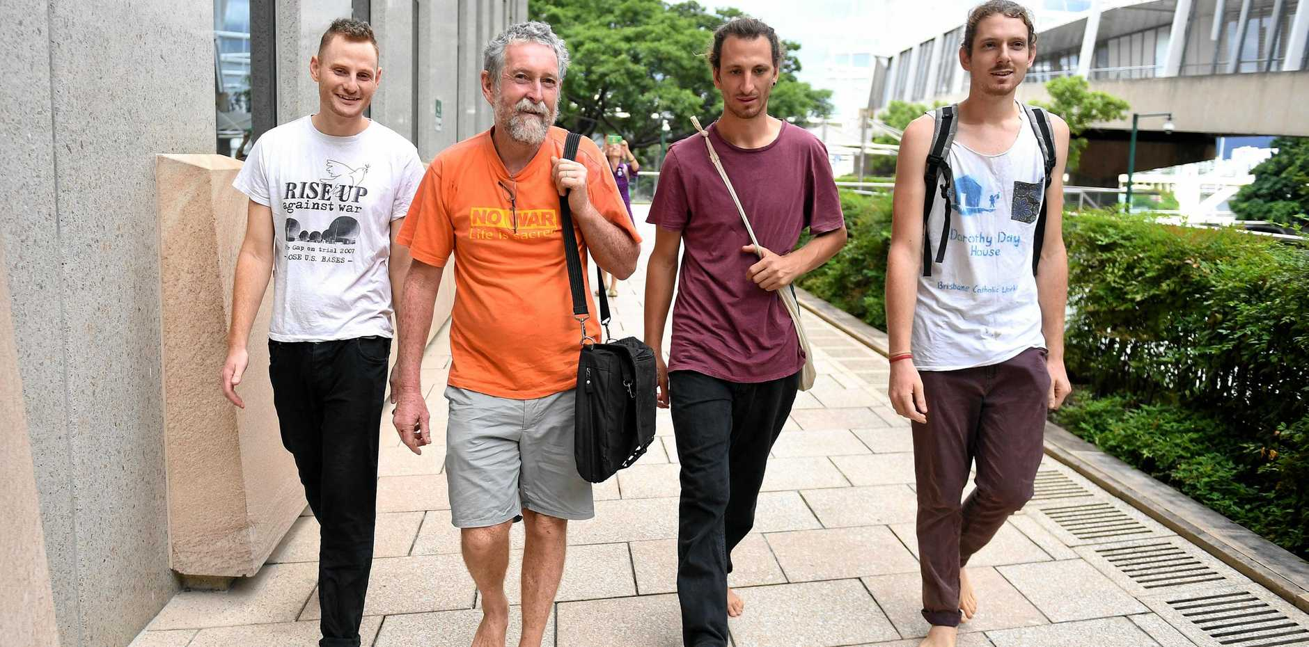 Convicted trespassers Andrew Paine, Jim Dowling, Tim Webb and Franz Dowling outside Brisbane Federal Court.
