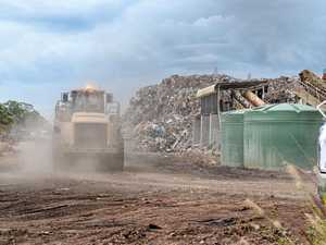 Huge rubbish pile building next to Ipswich suburb
