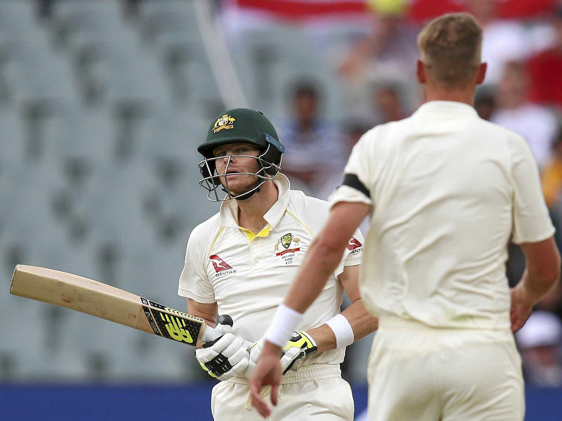Australia's Steve Smith, left, and England's Stuart Broad have words mid-wicket during their Ashes test match in Adelaide, Saturday, Dec. 2, 2017. (AP Photo/Rick Rycroft)