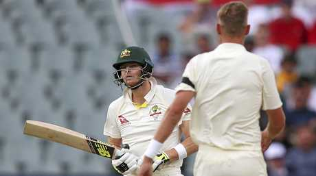 Australia's Steve Smith (left) and England's Stuart Broad have words in Adelaide.