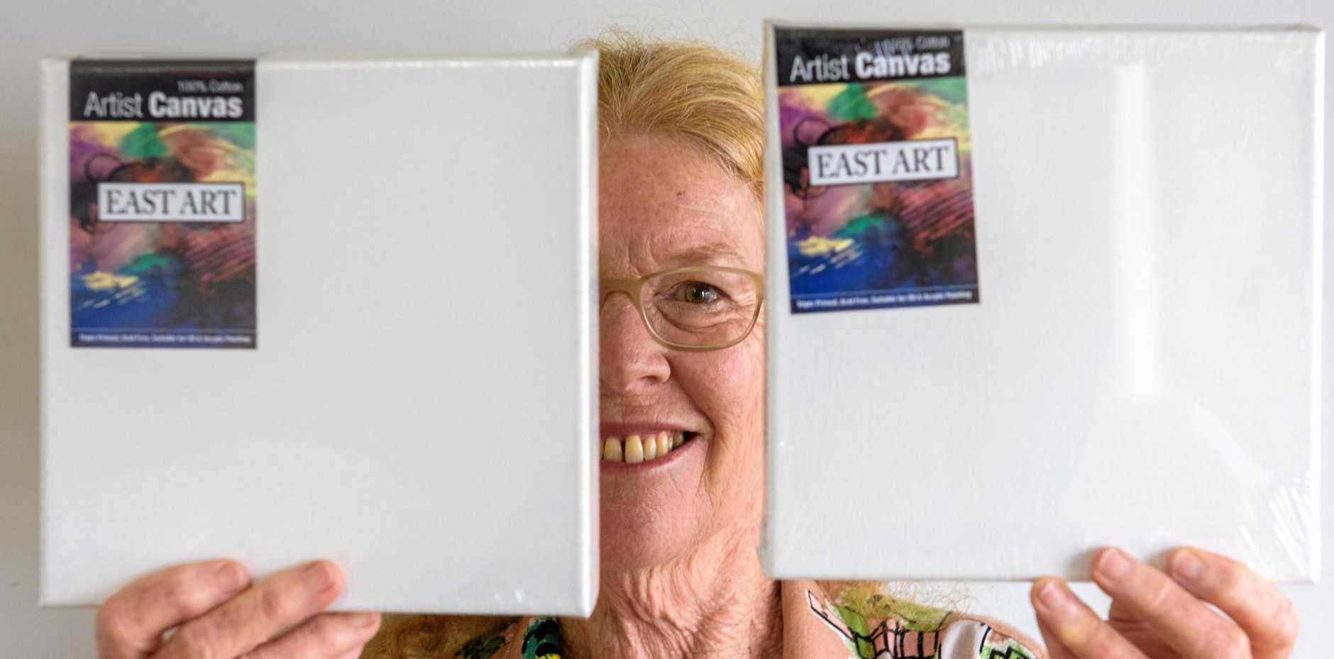 ART CHALLENGE: 8x8 exhibition curator Penny Stuart with the canvases entries must be made on.