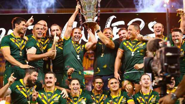 Australian team member's celebrate their victory in the Rugby League World Cup men's final match between Australia and England in Brisbane on December 2, 2017. / AFP PHOTO / Patrick HAMILTON / --IMAGE RESTRICTED TO EDITORIAL USE — STRICTLY NO COMMERCIAL USE —