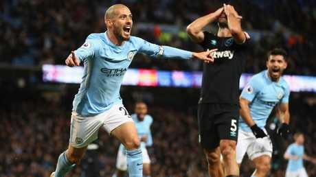 Silva celebrates scoring.
