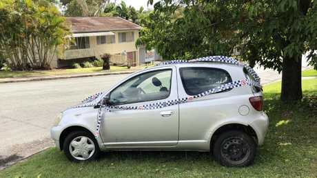 Joe Brooker's car after he was stuffed into the boot and pushed down a hill and then crashed into an Ashmore home's fence. Photo: Amanda Robbemond