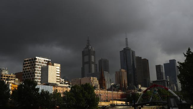A mixture of sunshine and showers hangs over Melbourne CBD. Monday, December 4. 2017. Picture: David Crosling