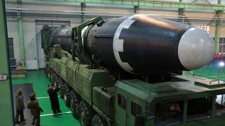 Kim Jong-un, third from left, inspects what the North Korean government calls the Hwasong-15 intercontinental ballistic missile. Picture: AP/KCNA