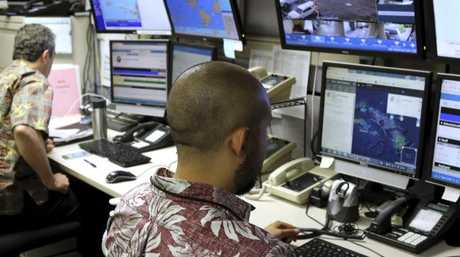 Hawaii Emergency Management Agency officials work at the department's command centre in Honolulu. Picture: Caleb Jones/AP