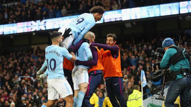 David Silva of Manchester City celebrates with teammates after scoring.