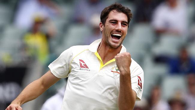 Australian fast bowler Pat Cummins celebrates taking the wicket of England's Dawid Malan on Monday.