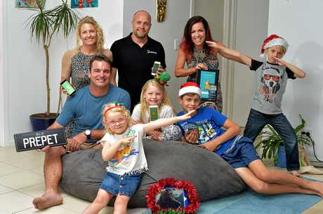 Launch of the new PetApp that tests whether kids were ready to have a pet. The App functions as a virtual pet and requires attention daily over a 21-day challenge to determine their commitment. (back l-r) Sheree Johnstone, Daniel McKinnon, Nicole Pedersen-McKinnon, Byron McKinnon, 7, (front) Jamie Johnstone, Darcy McKinnon, 4, Leila Johnstone, 7, and Beau Johnston, 11, launch the App.