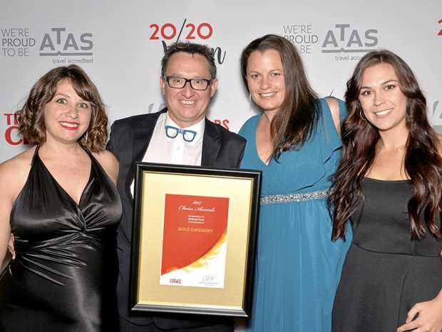 FLYING HIGH: The Windsong Travel team celebrate their Gold Choice Award.