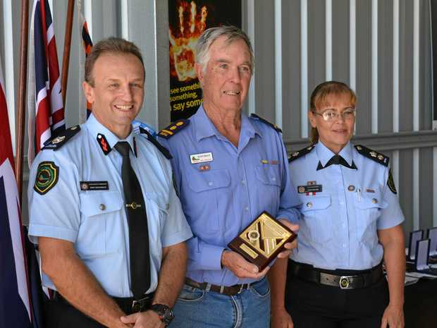 DEDICATION: Rusty Kraut was honoured for 50 years of service to the Rural Fire Brigade by Acting Assistant Commissioner Gary McCormack and Acting Superintendent Kaye Healing.