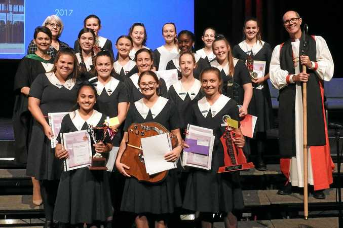 AWARD WINNERS: Glennie middle and senior years major award winners (back, from left) chair of school council Elizabeth Gillam, Alyssa Baker, Genevieve Dean, Lauren Baryla, Emma Prewett, Bella Mott and The Right Reverand Cameron Venerables (Bishop of the Western Region), (third row, from left) principal Kim Cohen, Lucinda Brodie, Katherine Chicalas, Ekene Aghanwa, Georgia Meise, (second row, from left) Angela Sharp, Lydia Paine, Ellen de Jong, Emilee Hockaday, (front, from left) Tanvi Chand, Phillipa Donaldson and Bianca Loughlin.