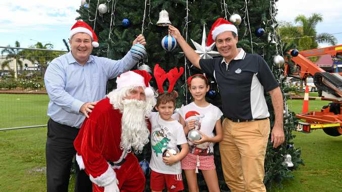 Mayor Jack Dempsey, Santa, Harrison Dart, Reece Dart and Ergon Energy's Michael Dart are encouraging the Bundaberg community to come and enjoy the Pageant of Lights this Thursday evening in Bourbong Street.