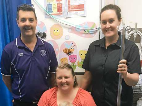 Warwick Hospital's midwife Ross Newton and clinical nurse Toni Alroy with Helen Kay and her son Caleb who benefitted from a piece of medical equipment donated by 1200kms for Kids Charity Bike Ride.